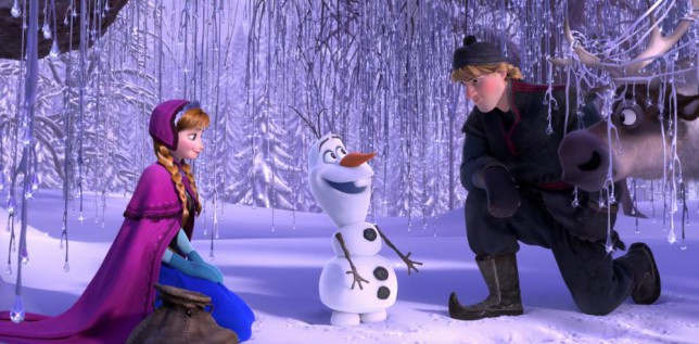 "Film: Frozen (2013).  This image released by Disney shows, from left, Anna, voiced by Kristen Bell, Olaf, voiced by Josh Gad, and Kristoff, voiced by Jonathan Groff in a scene from the animated feature ""Frozen.""   (AP Photo/Disney)"